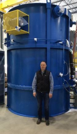 AHT President Mikel Woods with new gas nitriding unit